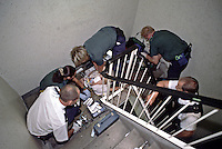 Paramedics treating patient on the staircase. This image may only be used to portray the subject in a positive manner..©shoutpictures.com..john@shoutpictures.com