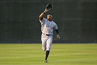 Center fielder Gregory Burns #25 of the Jacksonville Suns chases down a fly ball against the Carolina Mudcats at Five County Stadium May 15, 2010, in Zebulon, North Carolina.  Photo by Brian Westerholt /  Seam Images