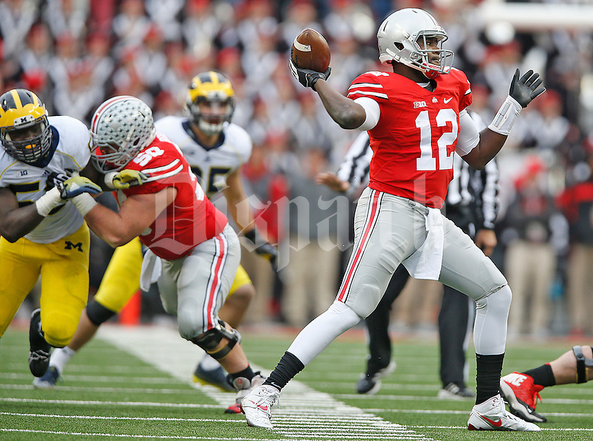 Ohio State Buckeyes quarterback Cardale Jones (12) came in to relieve Ohio State Buckeyes quarterback J.T. Barrett (16) after he was injured in the second half  at Ohio Stadium on November 29, 2014. (Chris Russell/Dispatch Photo)