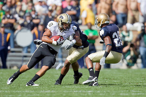 Purdue wide receiver Keith Smith (#8) makes catch in game action during NCAA football game between the Notre Dame Fighting Irish and the Purdue Boilermakers.  Notre Dame defeated Purdue 23-12 in game at Notre Dame Stadium in South Bend, Indiana.