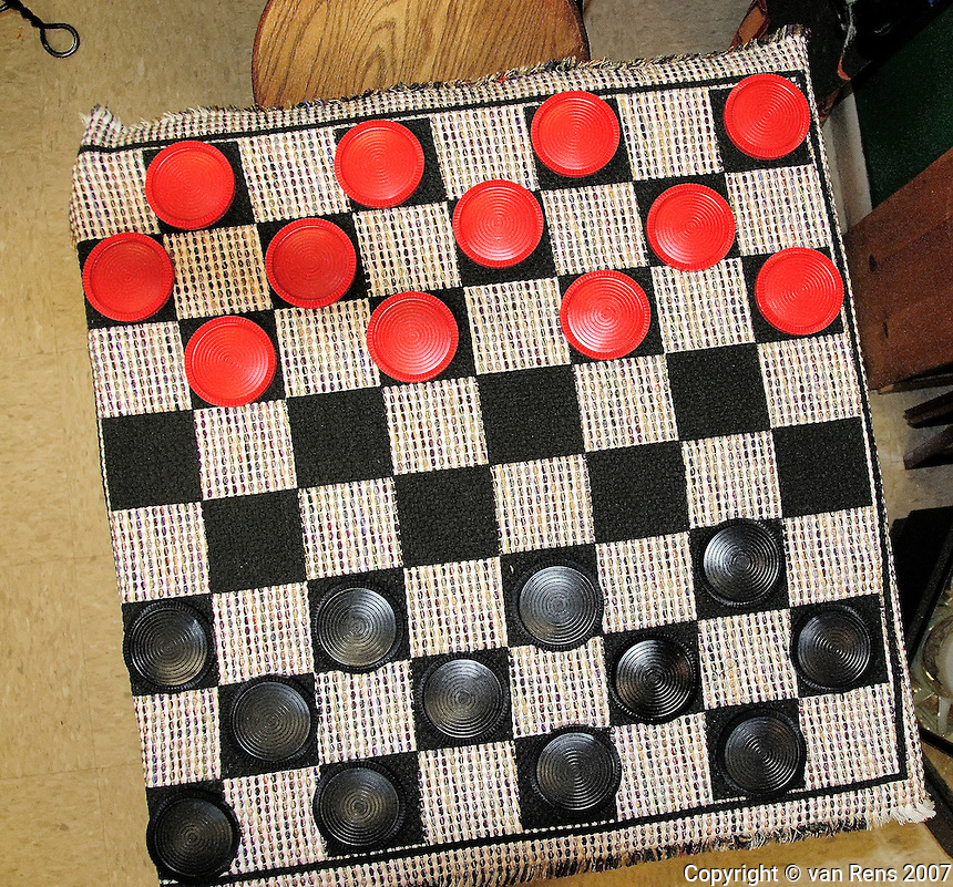 American  checkers on a fabric board awaits players
