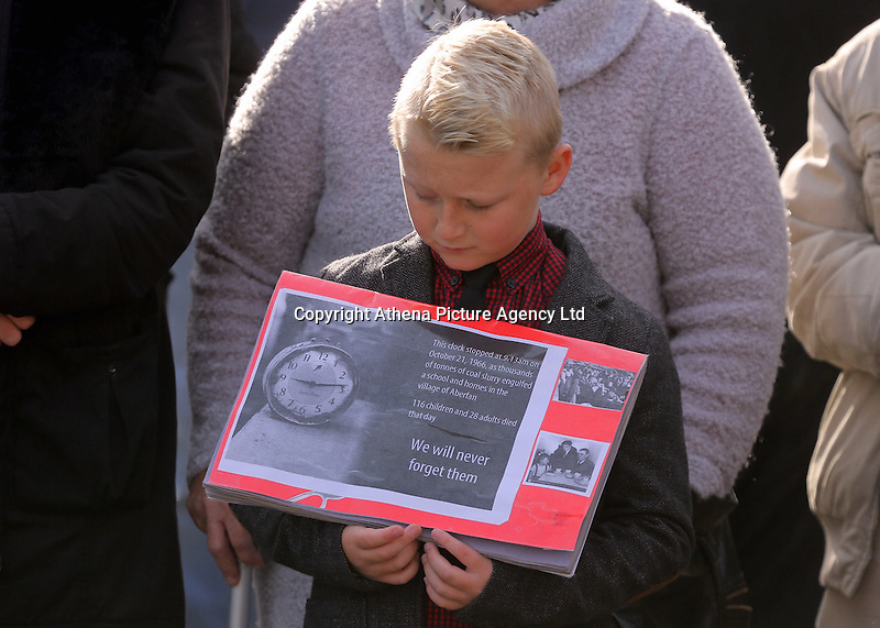 Pictured: A young boy with an album with pictures from the time at the Memorial Garden in Aberfan Friday 21 October 2016<br />Re: Wales has fallen silent as the country remembered the Aberfan disaster 50 years ago.<br />On 21 October 1966, a mountain of coal waste slid down into a school and houses in the Welsh village, killing 144 people, including 116 children.<br />A day of events to commemorate the disaster included a service at Aberfan Cemetery at 9:15am on Friday.<br />Prince Charles is visiting Aberfan memorial garden before unveiling a plaque in memory of the victims.<br />He will also attend a reception with the families of some of those who lost their lives, before signing a book of remembrance.