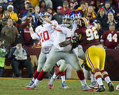 New York Giants quarterback Eli Manning (10) looks down field for wide receiver Tavarres King (15) in fourth quarter action against the Washington Redskins at FedEx Field in Landover, Maryland on Sunday, January 1, 2017.  Manning completed the pass which put the Giants in position to kick the game-winning field goal. Blocking for Manning is New York Giants guard John Jerry (77).  Washington Redskins defensive end Chris Baker (92) is looking to put pressure on Manning.  The Giants won the game 19 - 10.<br /> Credit: Ron Sachs / CNP<br /> (RESTRICTION: NO New York or New Jersey Newspapers or newspapers within a 75 mile radius of New York City)