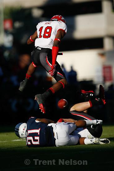 Trent Nelson  |  The Salt Lake Tribune.Utah's Eric Rowe leaps over Arizona's Gino Crump during the first half as Utah faces Arizona, college football at Arizona Stadium in Tucson, Arizona, Saturday, November 5, 2011.