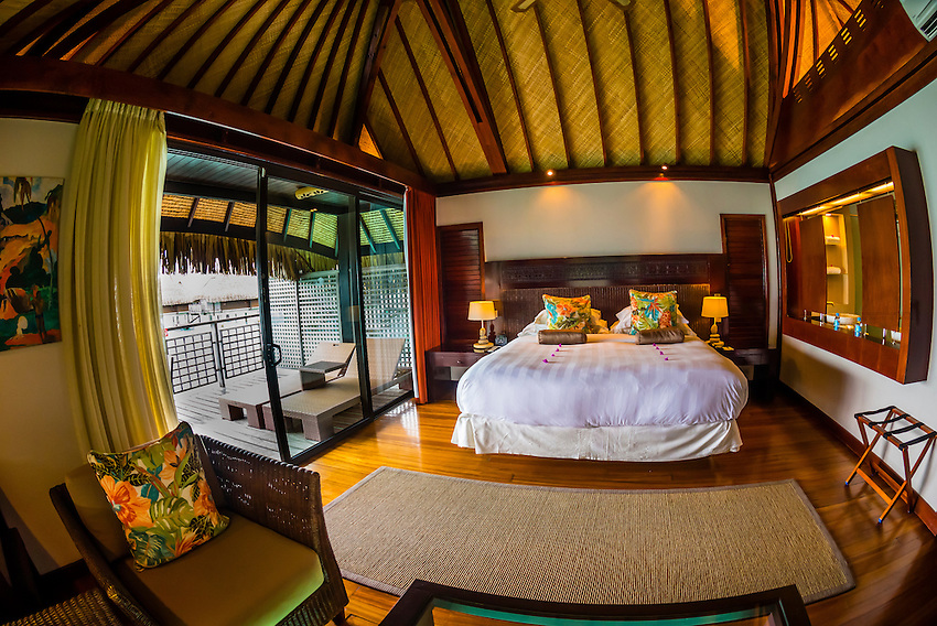 Interior view of a king panoramic overwater bungalow, Hilton Moorea Lagoon Resort, island of Moorea, French Polynesia.