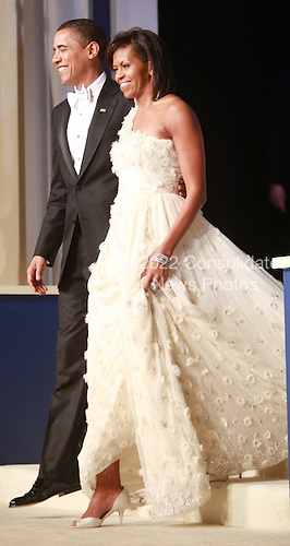 WASHINGTON - JANUARY 20:  (AFP OUT) President Barack Obama arrives with his wife Michelle Obama at the Mid-Atlantic Inaugural Ball at the Washington Convention Center on January 20, 2009 in Washington, DC. Obama became the first African-American to be elected to the office of President in the history of the United States.  .Credit: Mark Wilson - Pool via CNP