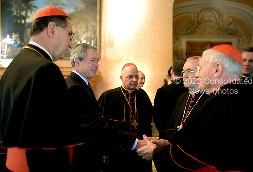 United States President George W. Bush greets American Cardinals during a reception Thursday, April 7, 2005, in Rome at Villa Taverna, the residence of the Mel Sembler, U.S. Ambassador to Italy.  From left are:  Roger Cardinal Mahony, archbishop of Los Angeles; President Bush; Francis Cardinal George, archbishop of Chicago; Justin Cardinal Rigali, archbishop of Philadelphia, and William Cardinal Keeler, archbishop of Baltimore. .Mandatory Credit: Eric Draper / White House via CNP