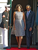 United States President Barack Obama and first lady Michelle Obama depart the Diplomatic Entrance as they host an Official Arrival ceremony in honor of Prime Minister Matteo Renzi and Mrs. Agnese Landini of Italy on the South Lawn of the the White House in Washington, DC on Tuesday, October 18, 2016. <br /> Credit: Ron Sachs / CNP