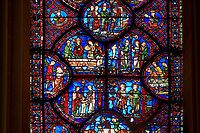Medieval stained glass Window of the Gothic Cathedral of Chartres, France - dedicated to St Sylvester.  Bottom left - The young Sylvester presented by his mother to the priest Cyrinus, bottom right - Sylvester welcoming St Timothy to his house. Side panel right - above right - Execution of St Timothy , side panel left - Death of the prefect Tarquin, who chokes on a fish bone. Two centre panels, left- Funeral of St Timothy, right - Sylvester refusing the prefect's orders to worship an idol. Top central oval panel - Sylvester released from prison by Pope Melchiades. A UNESCO World Heritage Site..