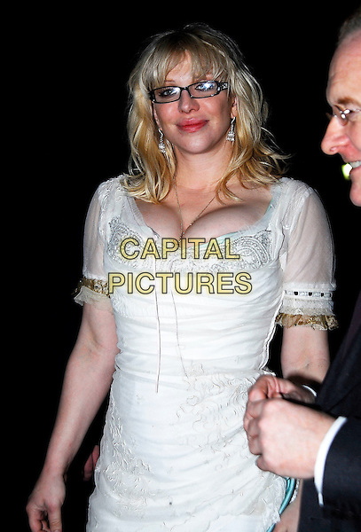 COURTNEY LOVE.Bad Sex In Fiction Prize, In & Out Club (The Naval Military Club), 4 James's Square, London, UK..November 29th, 2006.half length white dress cleavage glasses sheer.CAP/IA.©Ian Allis/Capital Pictures