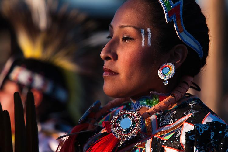 A woman dances during an intertribal dance during the evening powwow at Crow Fair.