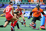 The Hague, Netherlands, June 14: Julia Reinprecht #12 of USA looks on as Jackie Kintzer #31 of USA makes a save during the field hockey bronze medal match (Women) between USA and Argentina on June 14, 2014 during the World Cup 2014 at Kyocera Stadium in The Hague, Netherlands. Final score 2-1 (2-1)  (Photo by Dirk Markgraf / www.265-images.com) *** Local caption ***