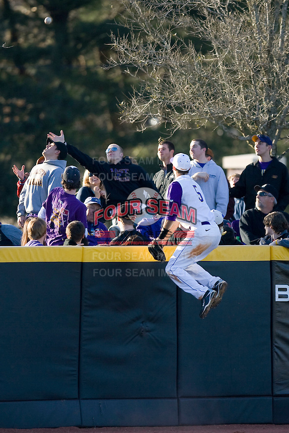 Left fielder Cameron Freeman #5 can only watch the flight of the baseball as it leaves the ballpark at Clark-LeClair Stadium on February 19, 2010 in Greenville, North Carolina.   Photo by Brian Westerholt / Four Seam Images