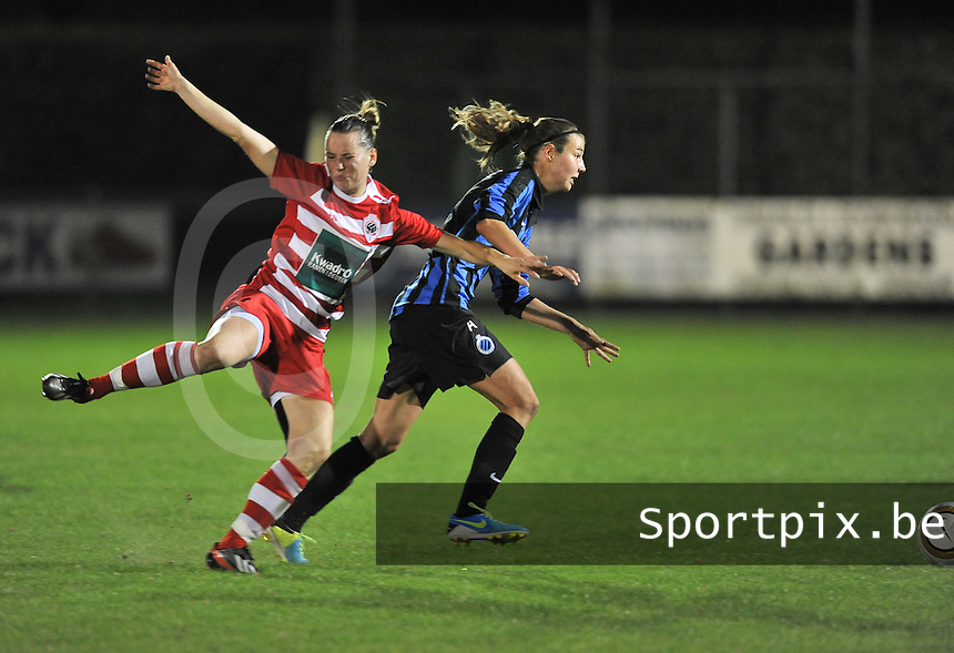 20131001 - VARSENARE , BELGIUM : Brugge's Nicky Van Den Abbeele (right) pictured in a duel with Antwerp Aafke Den Ridder (left) during the female soccer match between Club Brugge Vrouwen and Royal Antwerp FC Ladies , of the fifth matchday in the BENELEAGUE competition. Tuesday 1 October 2013. PHOTO DAVID CATRY