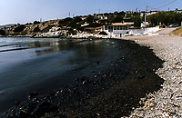 "Pictured: The oil spill that has reached the coast of Salamina, Greece<br /> Re: An oil spill off Salamina island's eastern coast is spreading and has become ""an environmental disaster"" according to local authorities in Greece.<br /> The spill was caused by the sinking of the Aghia Zoni II tanker, carrying 2,200 metric tons of fuel oil and 370 metric tons of marine gas oil on Saturday, southwest of the islet of Atalanti near Psytalleia. According to reports, the coastline stretching from Kinosoura to the Selinia community has ""turned black"" and authorities fear a new leak from the sunken ship.<br /> According to the island's mayor, Isidora Papathanasiou, the weather ""turned on Sunday afternoon and brought the oil spill to Salamina."""