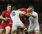 Jamie Roberts of Wales tackled by George Ford of England - RBS 6Nations 2015 - Wales  vs England - Millennium Stadium - Cardiff - Wales - 6th February 2015 - Picture Simon Bellis/Sportimage