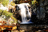 Looking Glass Falls, as the same so the scenic view. Water falling so clear with bright sunlight. Strean begins as the falls flow.