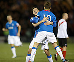 Fraser Aird celebrates with goalscorer Lewis Macleod