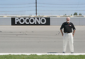 "Joseph ""Doc"" Mattioli the 80-some-year-old owner of the Pocono Raceway stands by the newly installed ""rumble strips"" at The Pocono Raceway in Long Pond, Pa. on Thursday July 21, 2005. NASCAR came to Mr.Mattioli and presented this idea, the first in the country. The rumble strips were hand crafted at 10 foot increments with an expansion joint every 30 feet at an 8 degree bank to distress the race car. The rumble strips are placed at the top of the track which is shaped like a triangle. Jane Therese for The New York Times."