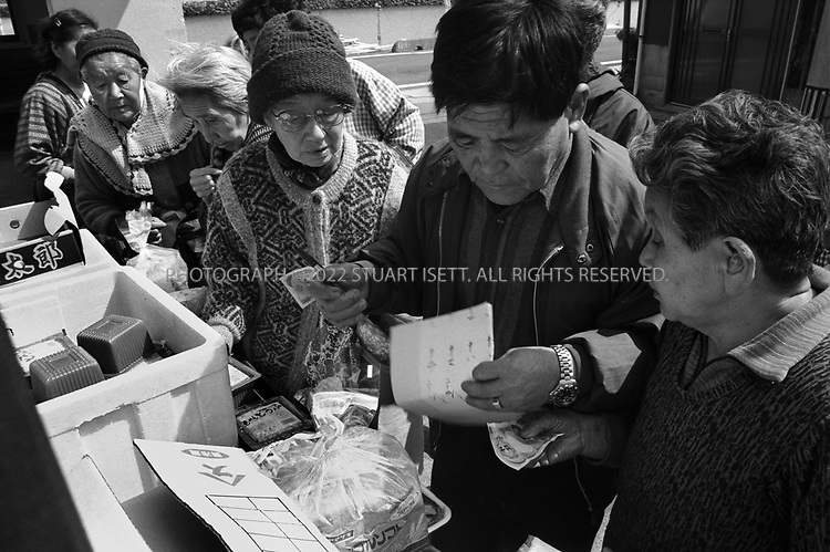 Towa, Japan..With no supermarkets Towa's elderly residents often depend on farmers driving into the town to sell produce directly from the backs of trucks...All photographs ©2003 Stuart Isett.All rights reserved.