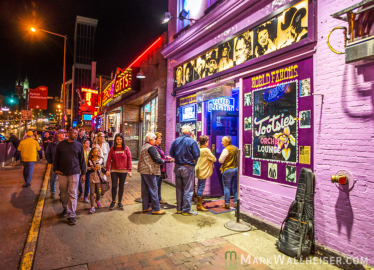 Tourist line up to get in Tootsie's Orchid Lounge on lower Broadway in Nashville, Tennessee