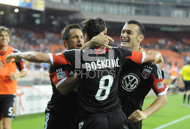 D.C. United forward Hamdi Salihi (9) celebrates his score in the 60th minute of the game with teammates Branko Boskovic (8) Danny Cruz (2) D.C. United defeated the Colorado Rapids 2-0 at RFK Stadium, Wednesday May 16, 2012.