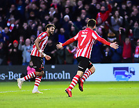 Lincoln City's Tom Pett, right, celebrates scoring his side's second goal with Bruno Andrade<br /> <br /> Photographer Andrew Vaughan/CameraSport<br /> <br /> Emirates FA Cup First Round - Lincoln City v Northampton Town - Saturday 10th November 2018 - Sincil Bank - Lincoln<br />  <br /> World Copyright © 2018 CameraSport. All rights reserved. 43 Linden Ave. Countesthorpe. Leicester. England. LE8 5PG - Tel: +44 (0) 116 277 4147 - admin@camerasport.com - www.camerasport.com