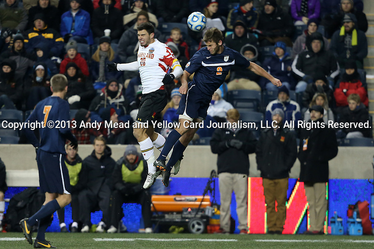 13 December 2013: Virginia's Zach Carroll (2) and Maryland's Jake Pace (20) challenge for a header. The University of Maryland Terripans played the University of Virginia Cavaliers at PPL Park in Chester, Pennsylvania in a 2013 NCAA Division I Men's College Cup semifinal match. Maryland won the game 2-1.