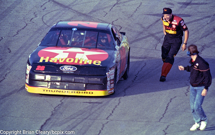 Davey Allison is greeted by crew members a she arrives on pit troad after winning a qualifying race for the Daytona 500, Daytona International Speedway, Daytona Beach, FL, February 14, 1991.  (Photo by Brian Cleary/www.bcpix.com)