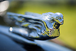 Westbury, New York, USA. June 12, 2016.  Flying Lady hood ornament close up on black vintage Cadillac is on display at the Antique and Collectible Auto Show at the 50th Annual Spring Meet at Old Westbury Gardens, in the Gold Coast of Long Island, and sponsored by Greater New York Region, GNYR, Antique Automobile Club of America, AACA. Participating vehicles in the judged show included hundreds of domestic and foreign, antique, classic, collectible, and modern cars and trucks.