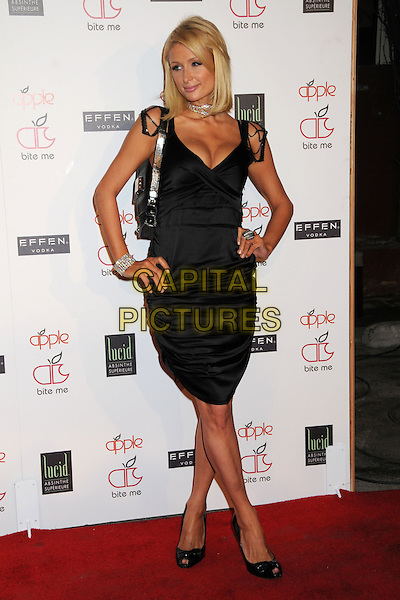 PARIS HILTON.Apple Lounge Grand Opening Party at Apple Lounge on Robertson, West Hollywood, California, USA..August 14th, 2008.full length black dress hands on hips cleavage .CAP/ADM/BP.©Byron Purvis/AdMedia/Capital Pictures.