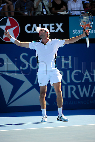 13.01.2012 Sydney, Australia. Benneteau wins the match and celebratesduring the men's Semi Final game. Marcos Baghdatis (CYP) V Julien Benneteau (FRA). Benneteau defeats Baghdatis 6-4 6-4 on centre court at the Australian Apia Internationa