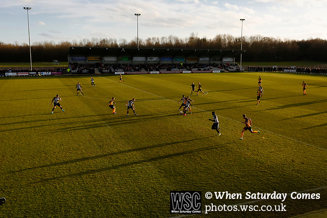 Long shadows on the pitch as Southport launch an attack. Darlington 1883 v Southport, National League North, 16th February 2019. The reborn Darlington 1883 share a ground with the town's Rugby Union club. <br /> After several years of relegations, bankruptcies, and ground moves, the club is fan owned, and back on an even keel in the National League North.<br /> A 0-0 draw with Southport was marred by a broken leg and dislocated knee suffered by Sam Muggleton, Darlington's on loan left back.<br /> Both teams finished the season in lower mid table.