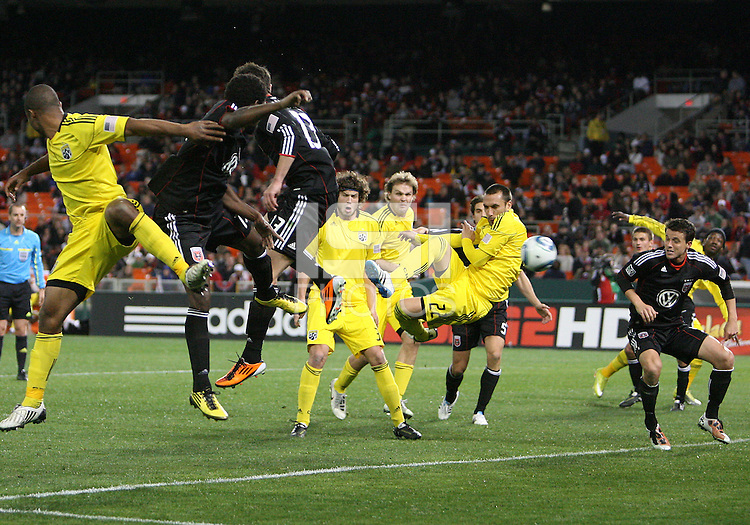 Chris Pontious#13 of D.C. United watches Dejan Rusmir#22 of the Columbus Crew take a shot during the opening match of the 2011 season at RFK Stadium, in Washington D.C. on March 19 2011.D.C. United won 3-1.