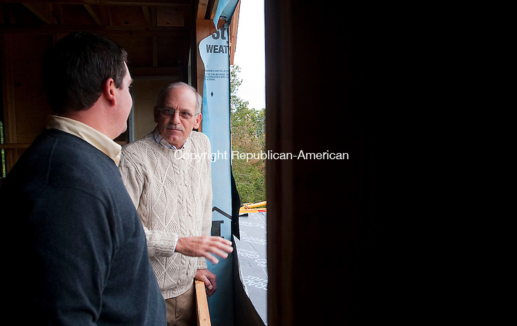 TORRINGTON, CT -26 SEPTEMBER 2012--092612JS15- Bob Bombardieri, Inn Keeper at The Inn at Mt. Pleasant in Torrington, speaks Torrington Mayor Ryan J. Bingham, during a tour of the home he is building on Wednesday. The home, located at 231 John Brown Road in Torrington, is one of  the high end homes proposed for the area.  .Jim Shannon Republican-American