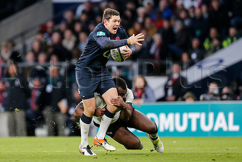 19.11.2016. Twickenham, London, England. Autumn International Rugby. England versus Fiji. Alex Goode of England is tackled by Peni Ravai of Fiji.   Final score: England 58-15 Fiji.