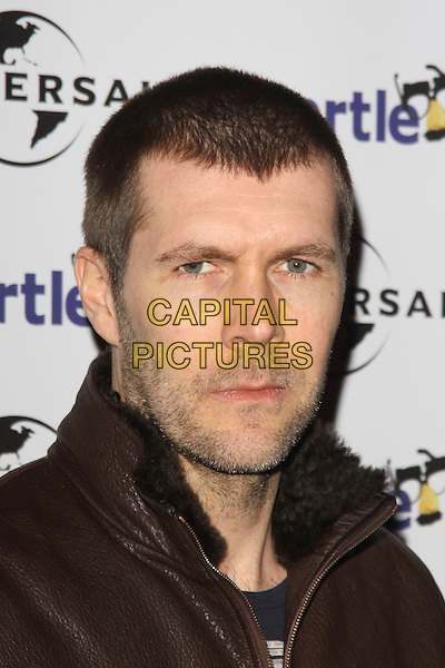 RHOD GILBERT .Chortle Comedy Awards at Floridita, London, England, UK, .February 7th, 2011..portrait headshot brown leather stubble facial hair .CAP/AH.©Adam Houghton/Capital Pictures.