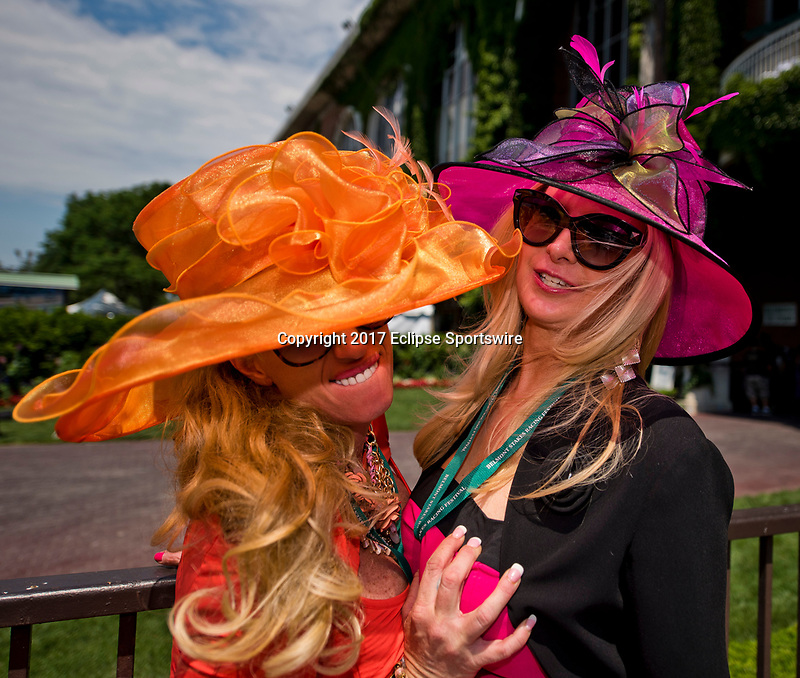 ELMONT, NY - JUNE 10: Two women pose for the camera on Belmont Stakes Day at Belmont Park on June 10, 2017 in Elmont, New York (Photo by Scott Serio/Eclipse Sportswire/Getty Images)