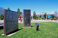 "Vancouver, BC, British Columbia, Canada - ""The Olympic Truce"" Aboriginal Artwork (artist: Corinne Hunt, installed 2010) at the Village on False Creek, BC Place Stadium in background"