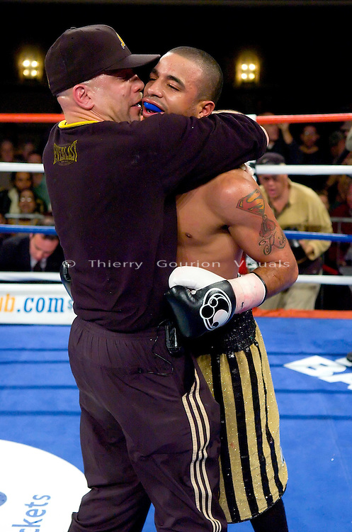 Gary Stark Jr. (r ) is hugged by his father and trainer, Gary stark Sr. after his  NY State Junior Featherweight Championship fight against  Vernie Torres at the Manhattan Center in N.Y.C on 12.14.06..Stark won by Unanimous decision.<br />