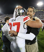 Ohio State Buckeyes defensive lineman Joey Bosa (97) celebrates the Buckeyes win with Coach Fickell at Beaver Stadium on October 25, 2014.  (Chris Russell/Dispatch Photo)