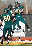 SPEARFISH, SD - NOVEMBER 23, 2013:  Jerome Krysl #86 of Black Hills State celebrates a touchdown with teammates after scoring against Western State Colorado University during their game Saturday at Lyle Hare Stadium in Spearfish, S.D. Black Hills State won 50-48 in triple overtime.  (Photo by Dick Carlson/Inertia)
