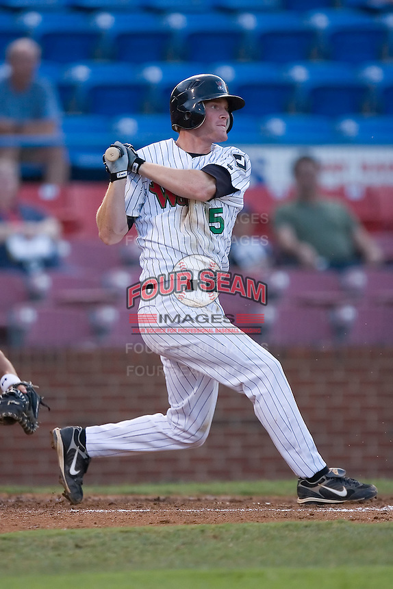 Dale Mollenhauer (15) of the Winston-Salem Warthogs follows through on his swing at Ernie Shore Field in Winston-Salem, NC, Thursday July 27, 2008. (Photo by Brian Westerholt / Four Seam Images)