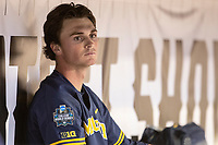 Michigan Wolverines pitcher Tommy Henry (47) in the dugout during Game 6 of the NCAA College World Series against the Florida State Seminoles on June 17, 2019 at TD Ameritrade Park in Omaha, Nebraska. Michigan defeated Florida State 2-0. (Andrew Woolley/Four Seam Images)