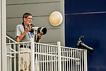 30 April 2017: Photographer Tony Quinn covers an MLB game between the Washington Nationals and the New York Mets from a high infield position at Nationals Park in Washington, DC. The Nationals defeated the Mets 23-5, with the Nationals setting several individual and team records, in the third game of their weekend series. Mandatory Credit: Ed Wolfstein Photo *** RAW (NEF) Image File Available ***