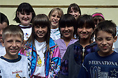 "Hungary. Group of smiling schoolchildren, one with an ""international"" sweatshirt."