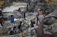 Gold mining on river banks outside of Prestea. The little girl in the photographs is said to have fallen out of bed during a blast and cut the back of her head.  The brain injury keeps her from walking well and she does not speak...Fixer is:.Kofi Adu Dankwah (+233 24 474 9756)
