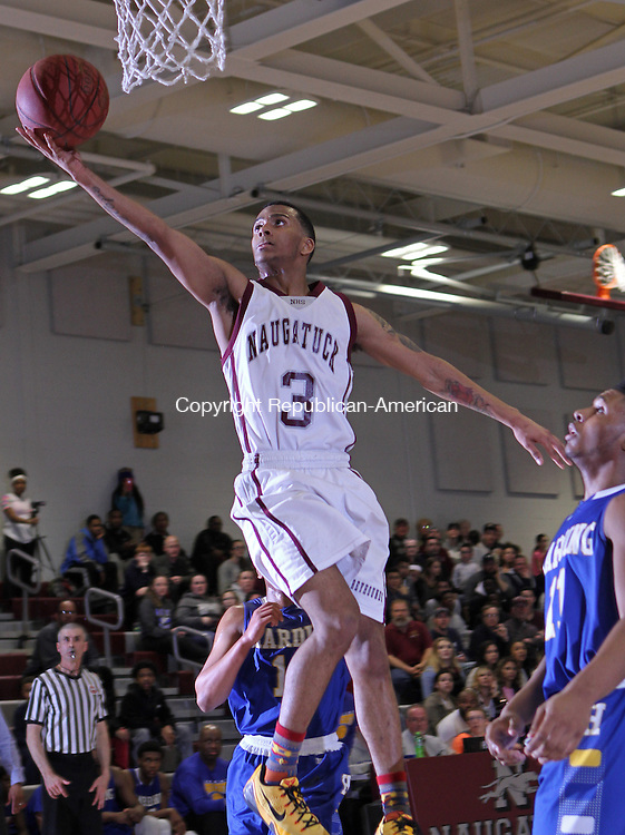 Naugatuck, CT-031015MK04  Naugatuck's Charles Wall (#3) goes for a layup over Warren Harding's defense Tuesday night during opening play of the Class L tournament at Naugatuck High School.  Naugy defeated Harding 60-59. Michael Kabelka / Republican-American
