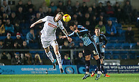 Jon Stead of Notts County beats Joe Jacobson of Wycombe Wanderers in the air during the Sky Bet League 2 match between Wycombe Wanderers and Notts County at Adams Park, High Wycombe, England on 15 December 2015. Photo by Andy Rowland.