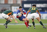 French replacement Jordan Merle is tackled by South African number 8 Gerrit van Velze during the Division A U19 World Championship clash at Ravenhill.